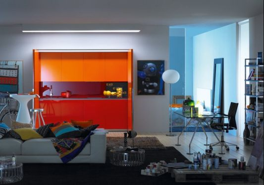 apartment living room with orange hidden kitchen