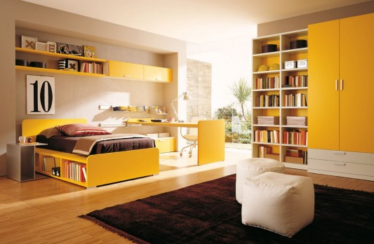 yellow color teen bedroom with modern combination bookshelves and wardrobes